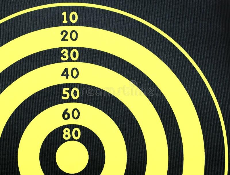 Darts board close up. Yellow and black board for darts game. stock photos