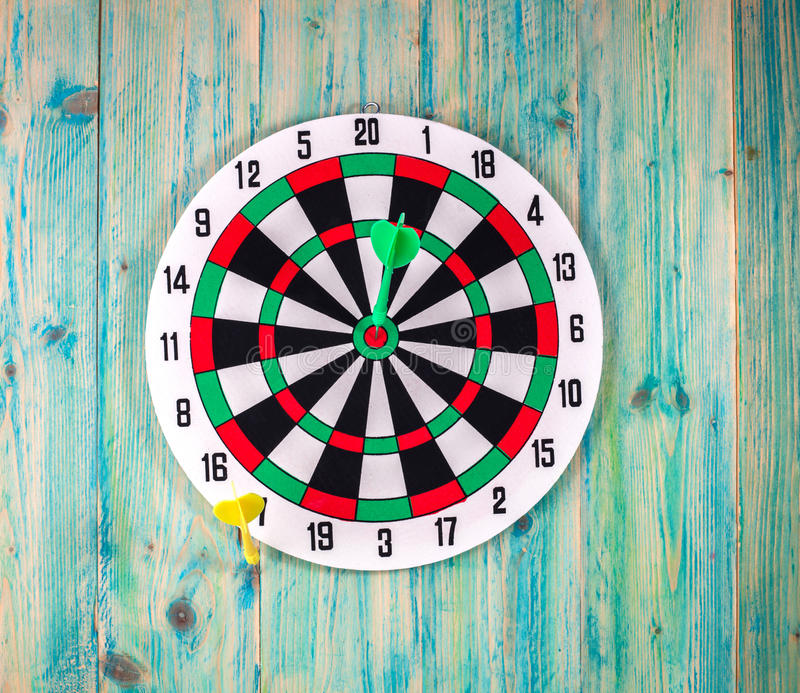 Darts Board with Twenty Black and White Sectors. Green and yellow Darts Board with Twenty Black and White Sectors royalty free stock image