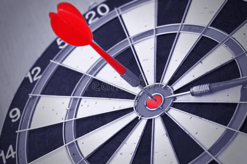 Darts in center of target royalty free stock photos