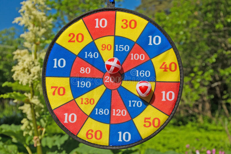 Darts. Children's game hit the mark royalty free stock photography