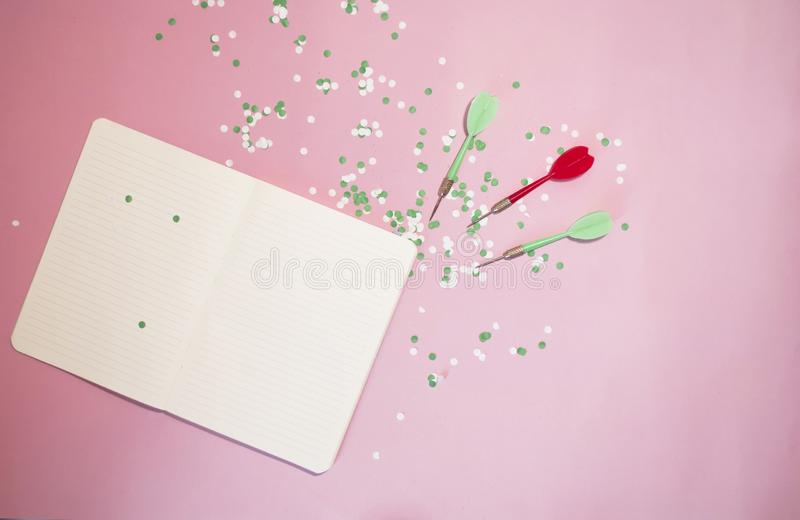Darts darts and notepad with place for text. Goal Achievement Concept. Darts darts and notepad with place for text. Goal Achievement  Concept royalty free stock image