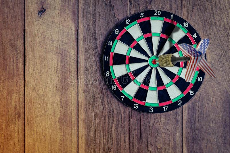 Darts embroidered on dartboard, dust the game focuses on success. Of investment, planning to be smart and Precise aim concept royalty free stock photography