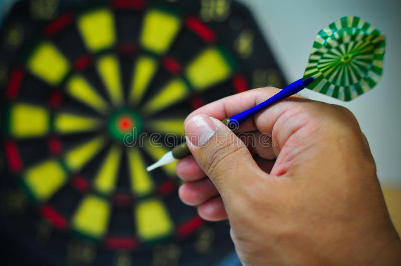 Darts game. Darts arrows in the target center, Darts game , arrows and darts target the exact game stock image