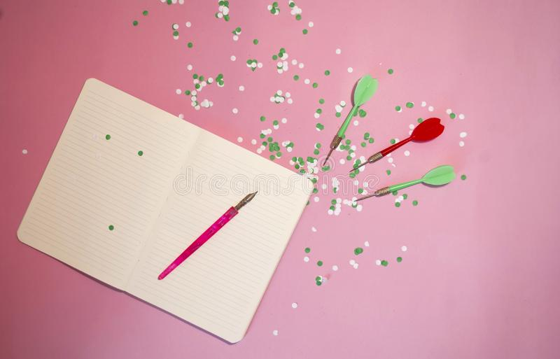 Darts darts and notepad with place for text. Goal Achievement Concept. Darts darts and notepad  with place for text. Goal Achievement Concept stock photography