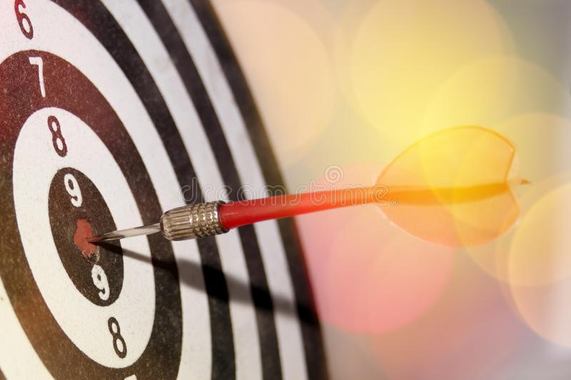 Darts selective focus. Lens flare and blur. Concept attainment, win and success. Winner skill. Perfect strategy and achievement. Darts selective focus. Lens royalty free stock photography