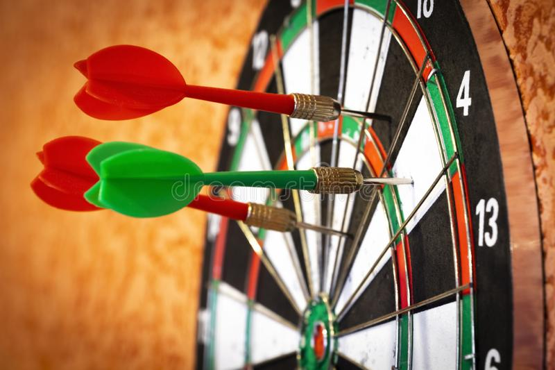 Darts in the target royalty free stock photo