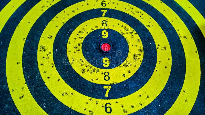 Darts target. Yellow used darts board target royalty free stock photo