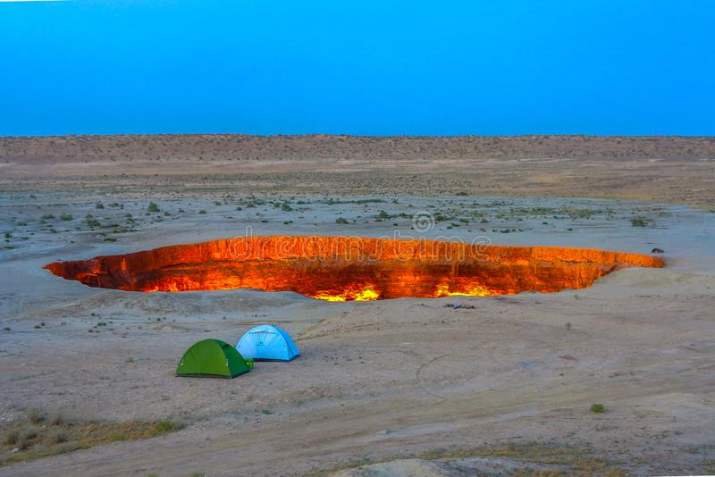 Darvaza Gas Crater Pit 10. Darvaza Gas Crater Pit Breathtaking Two Tents Awesome Appealing Amazing royalty free stock images