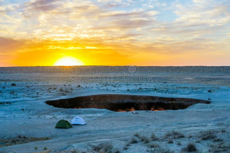 Darvaza Gas Crater Pit 20. Darvaza Gas Crater Pit Breathtaking Two Tents at Awesome Appealing Amazing Sunrise stock images