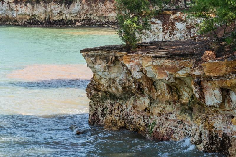 Closeup of East Point rocky shoreline, Darwin Australia. Darwin Australia - February 22, 2019: Closeup ofEast Point Shoreline shows brown, yellow and darker stock photos