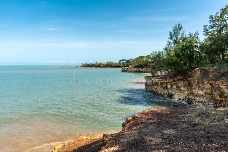 Long view on East Point rocky shoreline, Darwin Australia. Darwin Australia - February 22, 2019: Long view on East Point Shoreline shows brown, yellow and darker royalty free stock photography