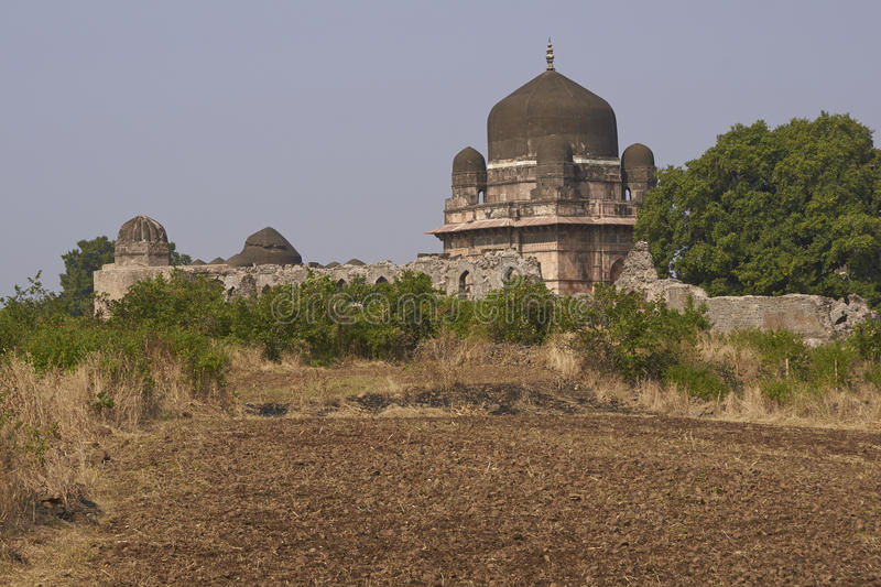 Darya Khan`s tomb in Mandu, India. Darya Khan`s tomb in the hilltop fortress of Mandu. Building with central dome and a smaller dome on each corner in a walled stock photo
