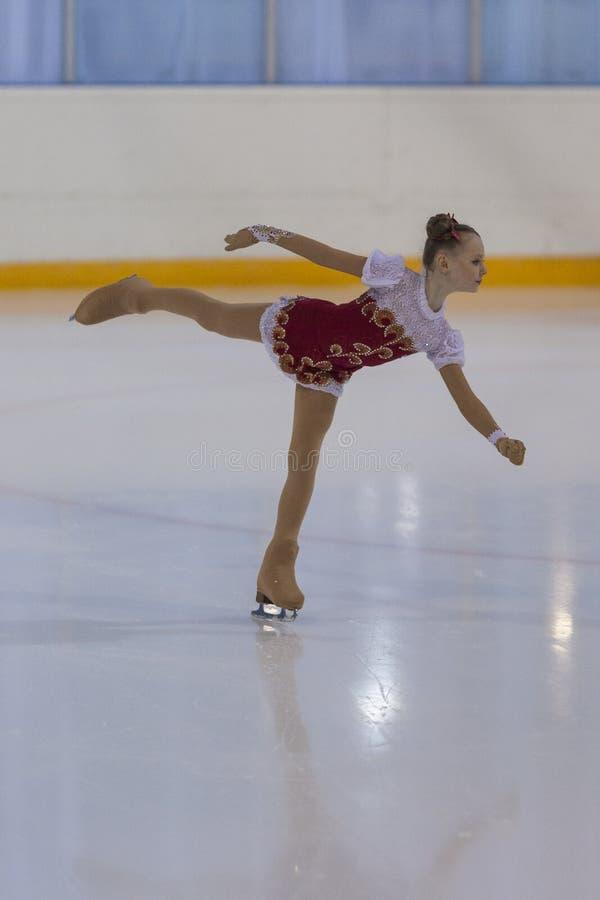 Darya Podosenova dalla Russia esegue il programma pattinante libero delle ragazze bronzee della classe III immagine stock libera da diritti