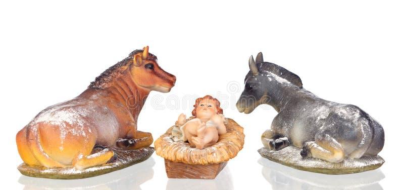 Das Baby Jesus in der Krippe mit dem Ochsen und dem Maultier stockfotos