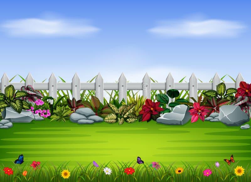 Das einfache Yard mit dem Zaun und dem großen Stein stock abbildung