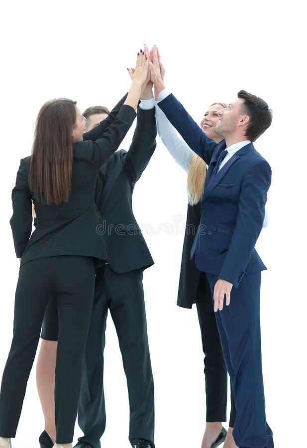 Das erfolgreiche Geschäftsteam, das ein Hoch fives gibt, gestikulieren als sie lau stockbilder