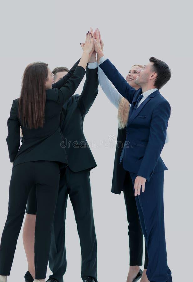 Das erfolgreiche Geschäftsteam, das ein Hoch fives gibt, gestikulieren als sie lau stockbild