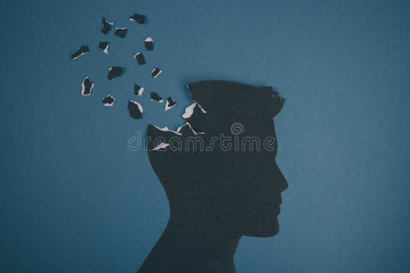 Das Gehirnstörungssymbol, das durch menschlichen Kopf dargestellt wurde, machte Formpapier Kreative Idee für Alzheimerkrankheit,  stockbilder