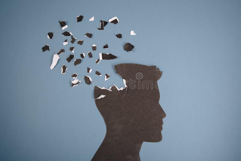 Das Gehirnstörungssymbol, das durch menschlichen Kopf dargestellt wurde, machte Formpapier Kreative Idee für Alzheimerkrankheit,  stockfotografie