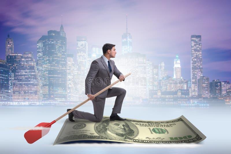 Das Geschäftsmannrudersport auf Dollarboot im Geschäftsfinanzkonzept stockfoto