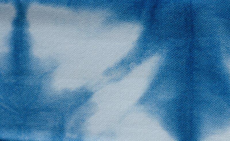 Das Gewebe ist Indigofärbungshintergrund lizenzfreies stockbild