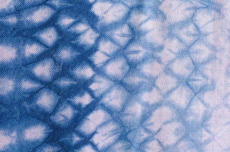 Das Gewebe ist Indigofärbungshintergrund lizenzfreie stockfotografie
