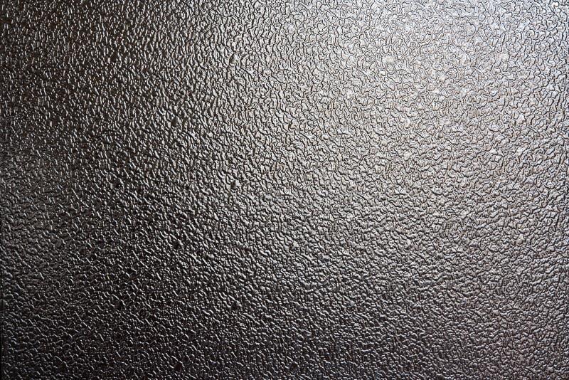 Das Hintergrundglas ist strukturierte dunkelgraue Farbe stockfotos