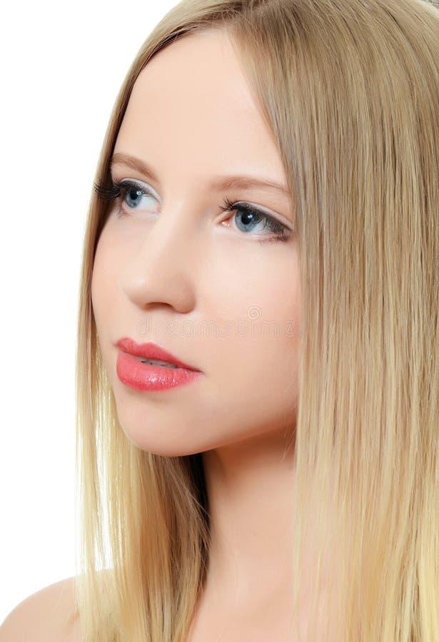Das junge schöne Mädchen mit Make-up stockbild