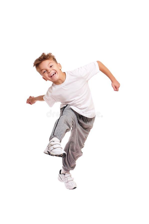 Das Jungenspringen lizenzfreies stockbild