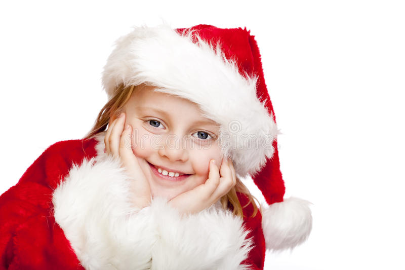 Das kleine Kind, das als Weihnachtsmann gekleidet wird, lächelt glücklich stockfotos