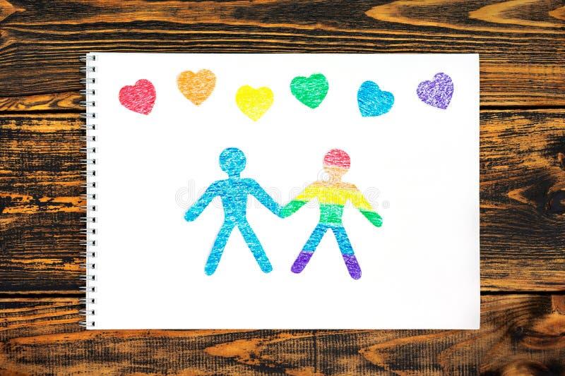 Das Konzept der Freundschaft Papierpuppenleute geschnitten vom Papier stockfotografie