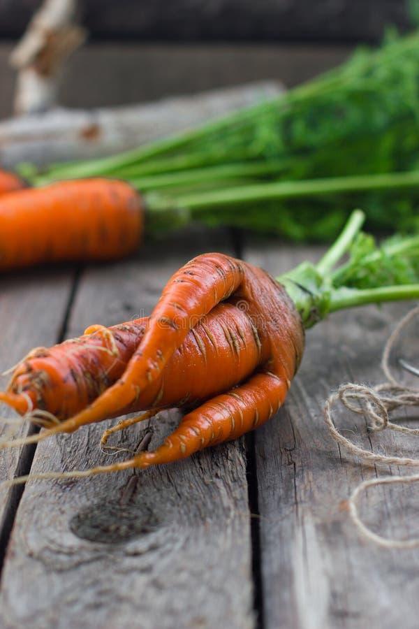 Das Konzept von Karotten der gesunden Ernährung stockbilder