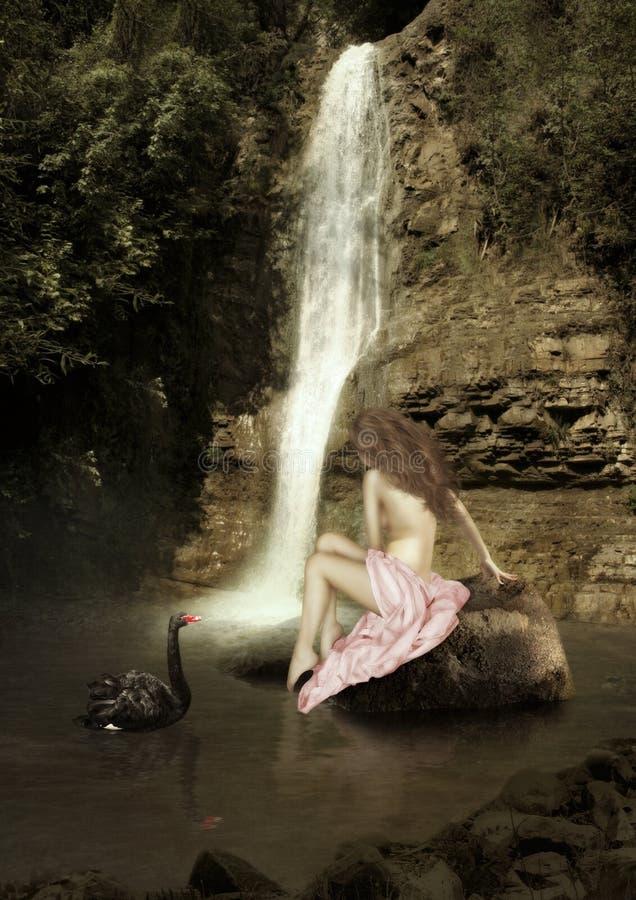 Das Mädchen, das auf dem Stein sitzt stockfotos