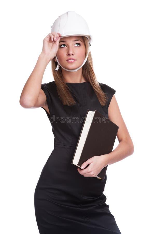 Das Mädchen in einem Sturzhelm lizenzfreie stockfotos