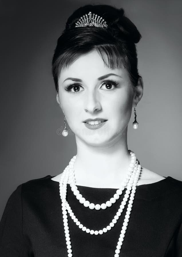 Das Mädchen im Bild von Audrey Hepburn stockbilder