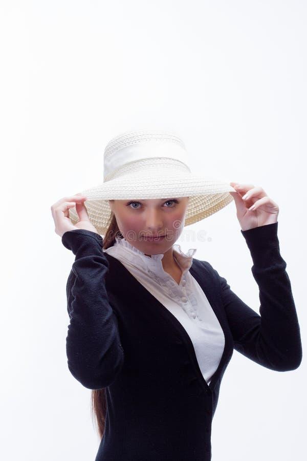 Das Mädchen im Hut lizenzfreie stockfotos
