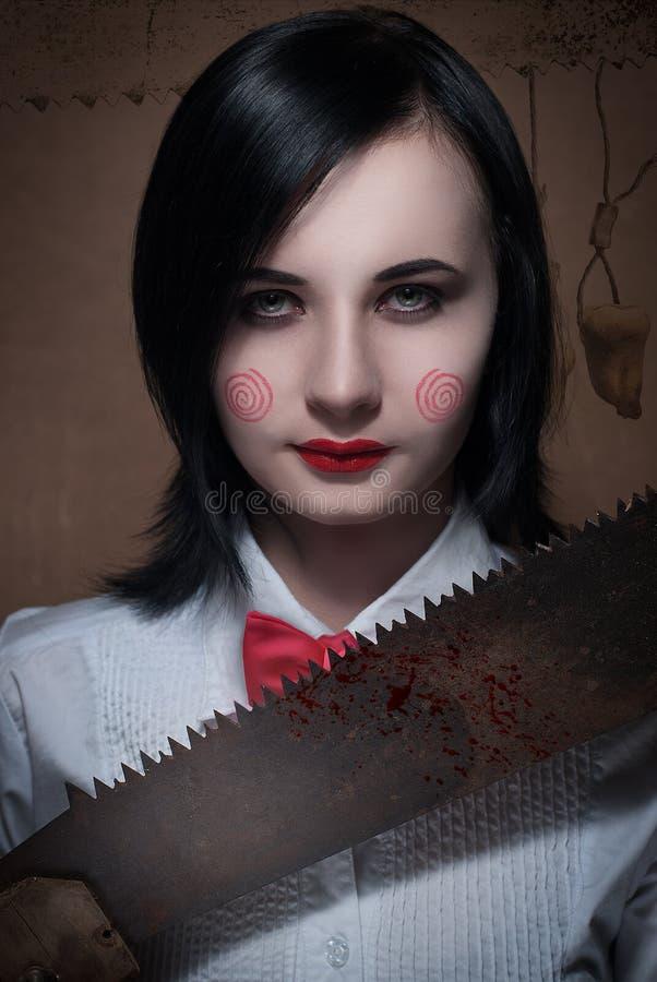 Das Mädchen mit dem cosplay Make-up des Sägefilms lizenzfreies stockfoto