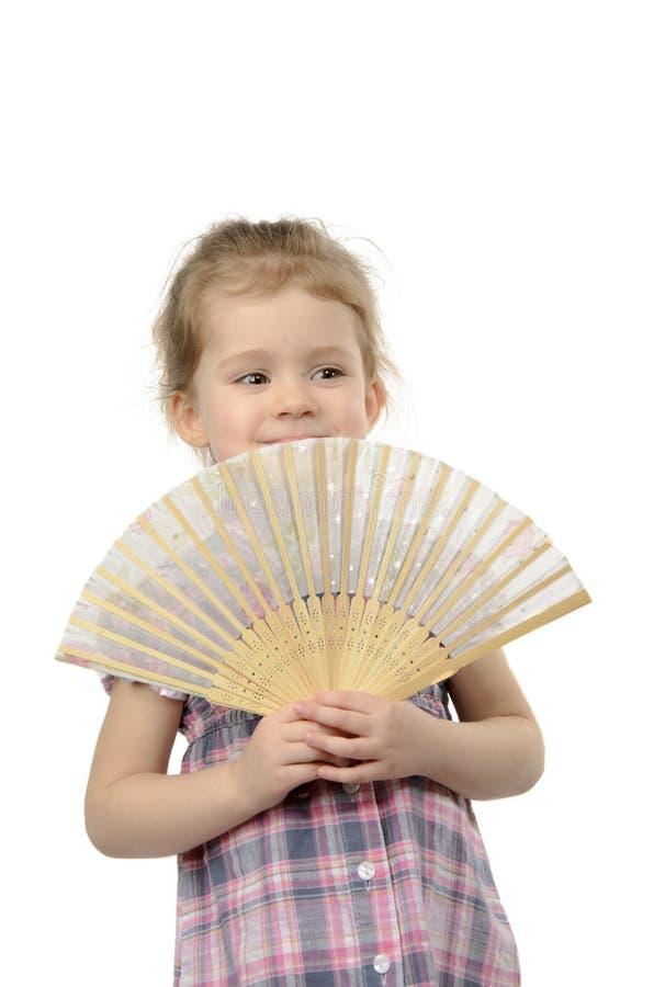 Das Mädchen mit einem Fan stockfoto