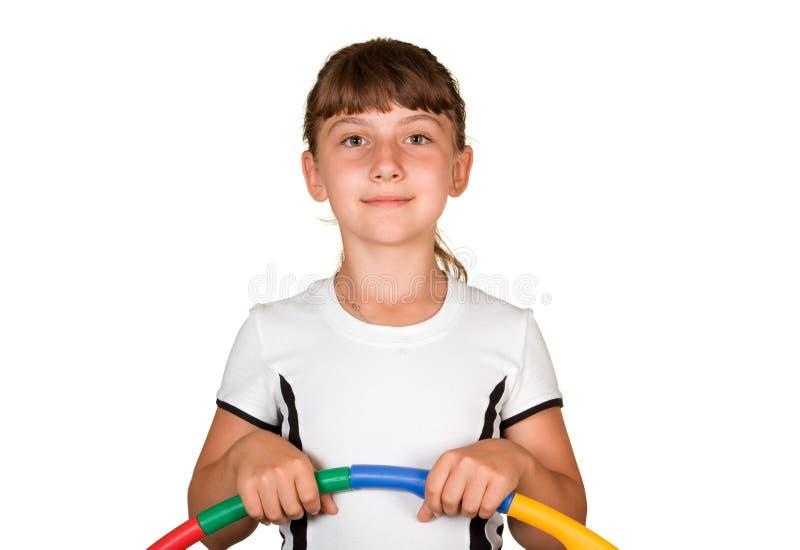 Das Mädchen mit einem gymnastischen Band stockfotos