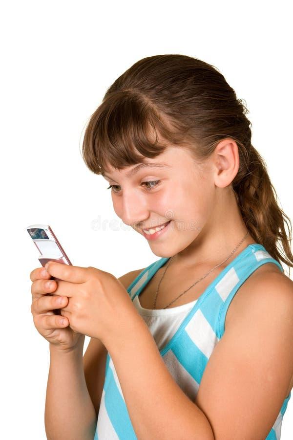 Das Mädchen mit Handy stockbilder