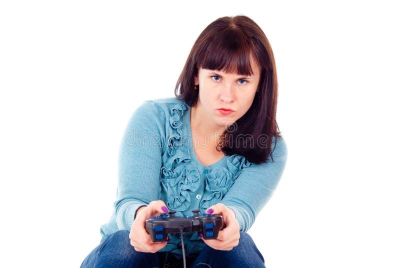 Das Mädchen spielt fanatisch im Videospiel lizenzfreies stockfoto