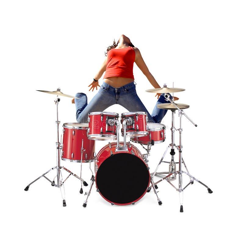 Das Mädchen springend mit Trommelsatz stockfotografie