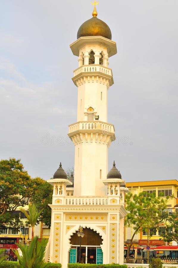 Das Minarett der Moschee Kapitan Keling während des Sonnenuntergangs lizenzfreie stockfotografie