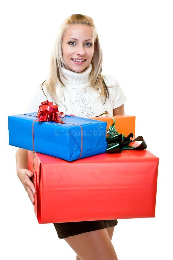 Das nette Frauengeben Weihnachten-bewegen ruckartig lizenzfreie stockfotos
