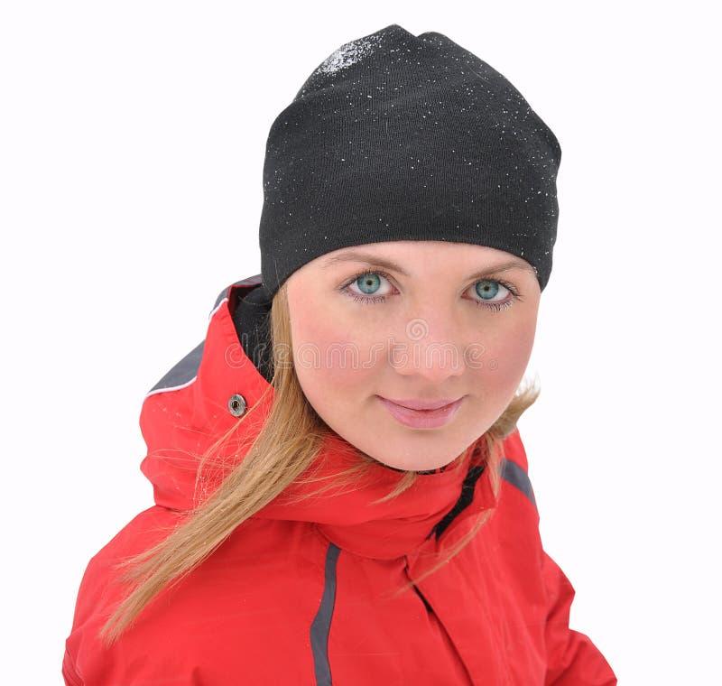 Das schöne Mädchen in einer roten Jacke stockbilder