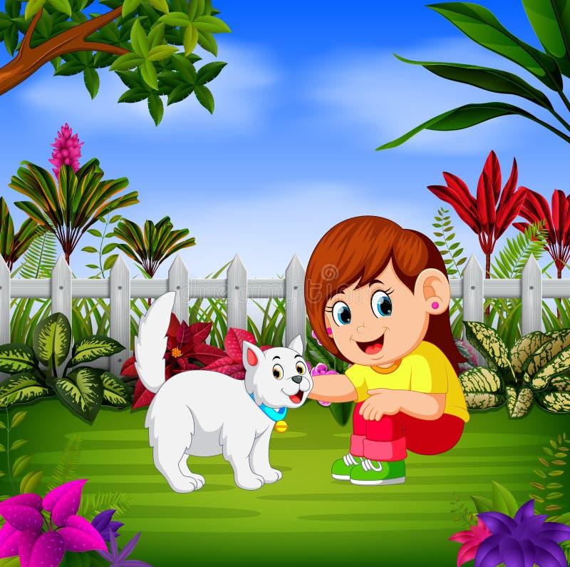 Das schöne Mädchen spielt mit ihrer Katze nahe dem Zaun stock abbildung
