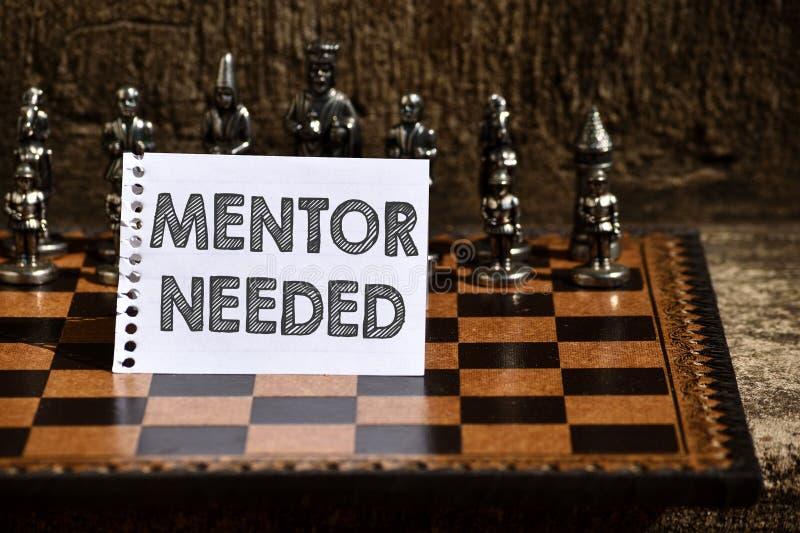 Das Schreiben von Anmerkungsvertretung Mentor brauchte Geschäftsfoto, das gewünschte Hilfe für erfahreneres oder sachkundiger zur lizenzfreie stockfotografie