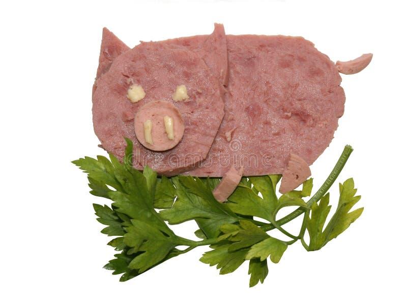 Das Schwein, gebildet von den Stücken eines Schinkens stockbilder
