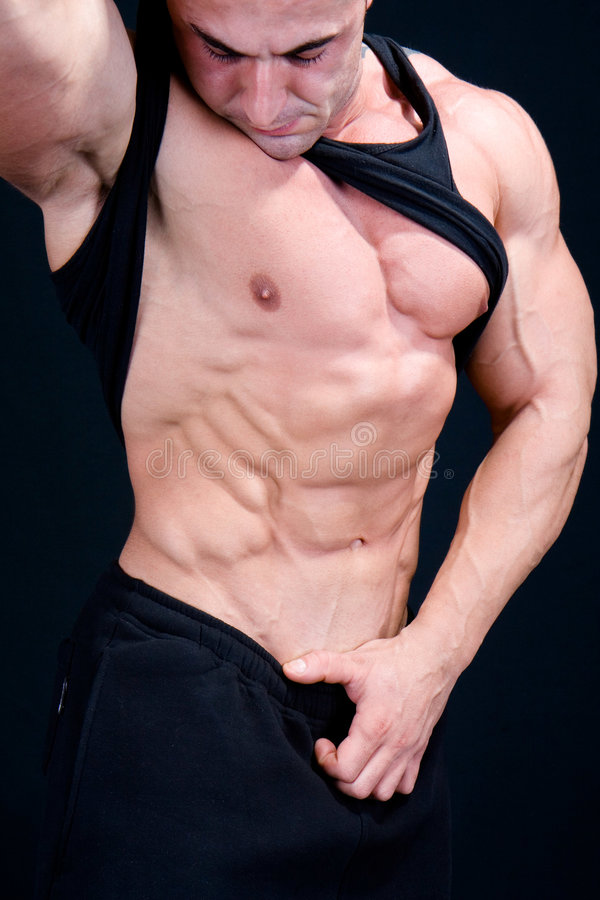Das vollkommene muskulöse männliche Baumuster stockbilder