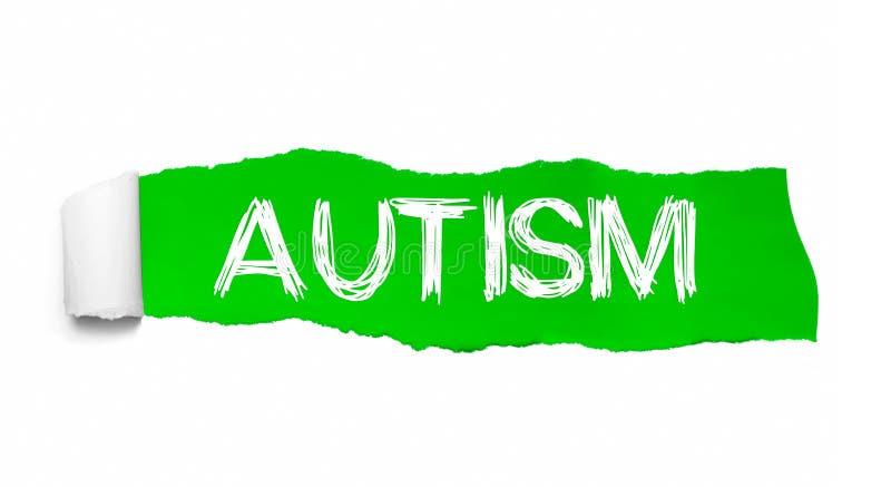 Das Wort AUTISMUS, der hinter grünem heftigem Papier erscheint lizenzfreies stockfoto